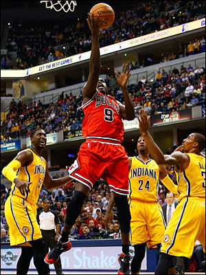 Deng goes in for a lay up against the Pacers
