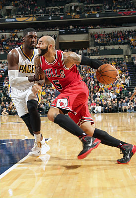 """[Supposedly] an inside/outside team, the Bulls rarely got the ball into the paint or to Carlos Boozer in the post,"" notes Smith. ""Boozer had six points and nine rebounds, but few post touches."""