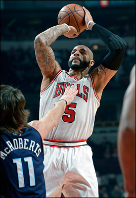 Though he shot just five of 17 for 12 points, Carlos Boozer had a dominant rebounding game with 17 as the Bulls had a 54-44 edge on the boards.