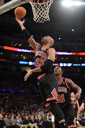 Taj Gibson scores off the glass