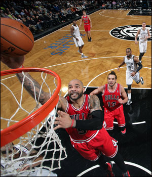 The Nets moved to 29-29 while Boozer and the Bulls are 33-27 with just their second loss in the last 11 games.