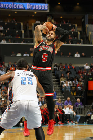 Carlos Boozer and the Bulls with Wednesday's regular season ending 91-86 overtime loss to the Charlotte Bobcats fell to the No. 4 seed in the Eastern Conference in a bracket with first round opponent Washington and the Indiana Pacers playing the Atlanta Hawks.
